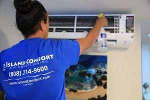 Air Conditioner tech repairing a unit