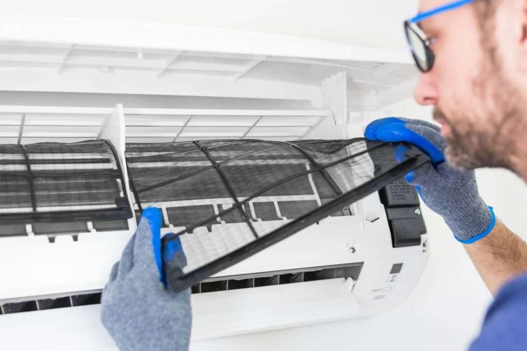 man changing AC filter